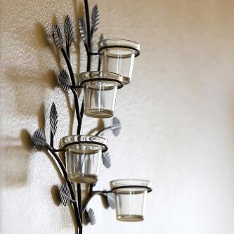 Wandkerzenhalter für mehrere Teelichter aus Metall und Glas